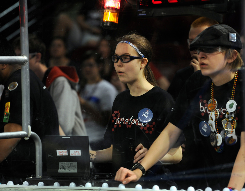 ". DENVER, CO.- APRIL 6: Allison Fisher, 14, left, and Grant Hill, 18, are drivers for the Denver School of Science and Technology, team ""Brute Force\"". The Colorado Regional FIRST Robotics Competition takes place in Magness Arena inside the Ritchie Center on the University of Denver campus. High School students from all over the state, region, and even a team from Mexico, participate in a high-tech spectator sporting event (this year the teams used frisbees) using specially engineered robots that are maneuvered by human drivers using computers and joy sticks.(Photo By Kathryn Scott Osler/The Denver Post)"