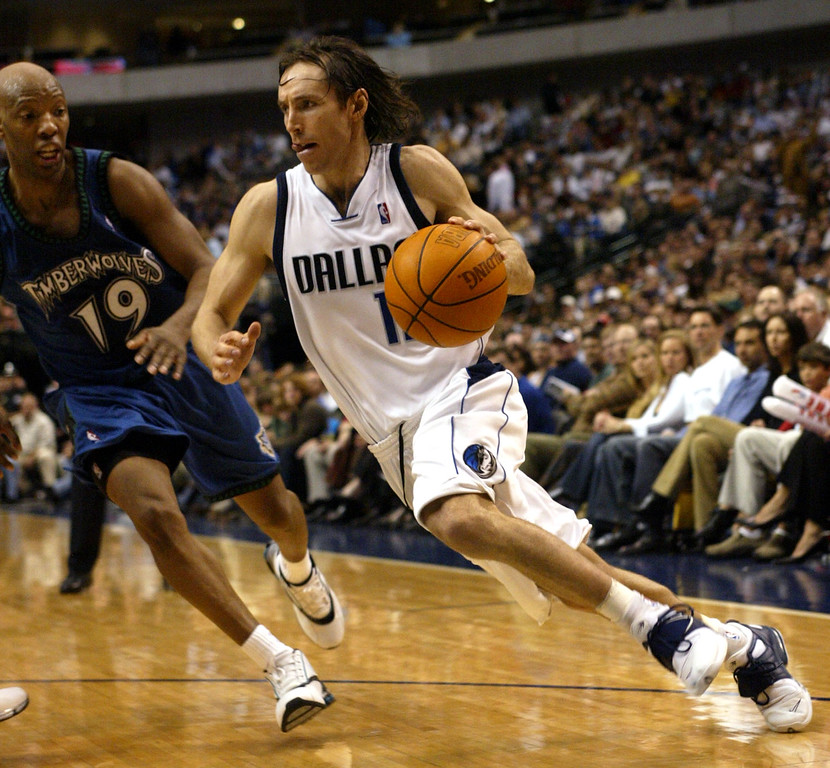. Dallas Mavericks guard Steve Nash, right, from Canada, drives past Minnesota Timberwolves guard Sam Cassell in the fourth quarter of their game in Dallas, Saturday, Jan. 3, 2004.   (AP Photo/Donna McWilliam)