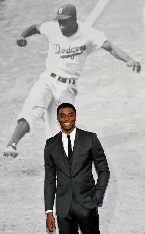 ". Chadwick Boseman, who plays baseball legend Jackie Robinson in ""42,\"" poses at the Los Angeles premiere of the film at the TCL Chinese Theater on Tuesday, April 9, 2013 in Los Angeles. (Photo by Chris Pizzello/Invision/AP)"