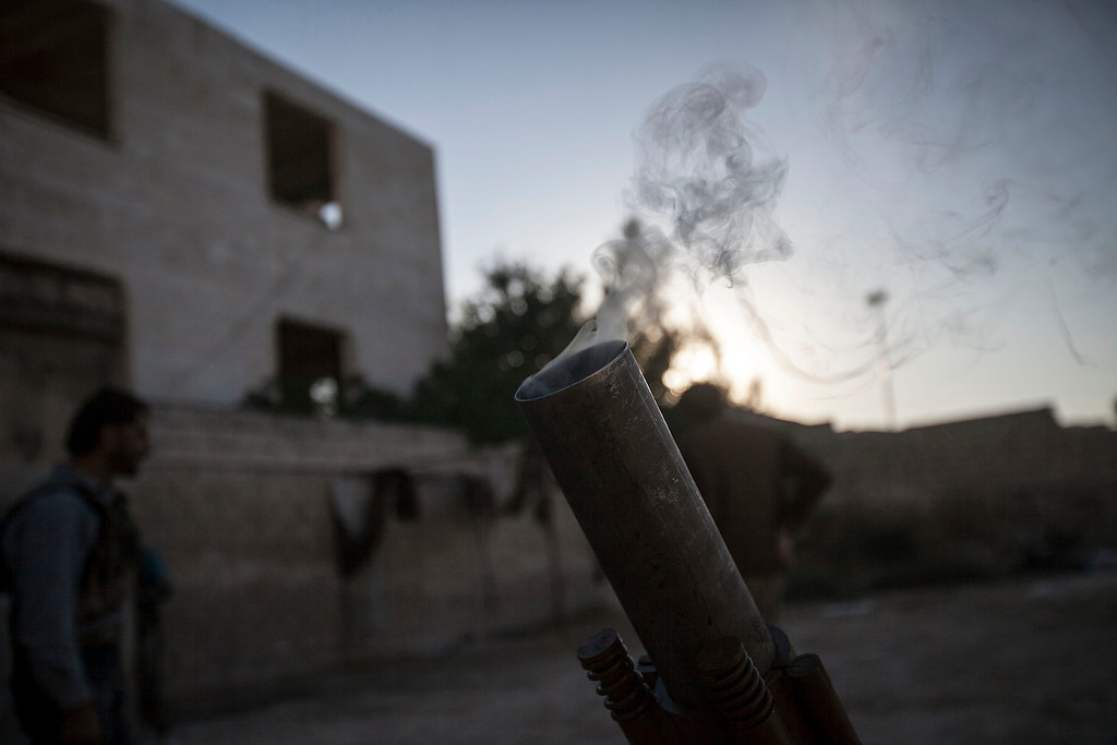 . A launcher smokes after a fire by opposition fighters during their attack over Syrian government forces\' Wadi al-Deef military post in Maaret al-Numan in the Idlib province, Syria, Tuesday, Oct. 8, 2013. Syrian government warplanes bombed rebel positions near the strategic northern city on Tuesday, activists said, as international inspectors toured production and storage sites of the country\'s chemical weapons arsenal. (AP Photo)