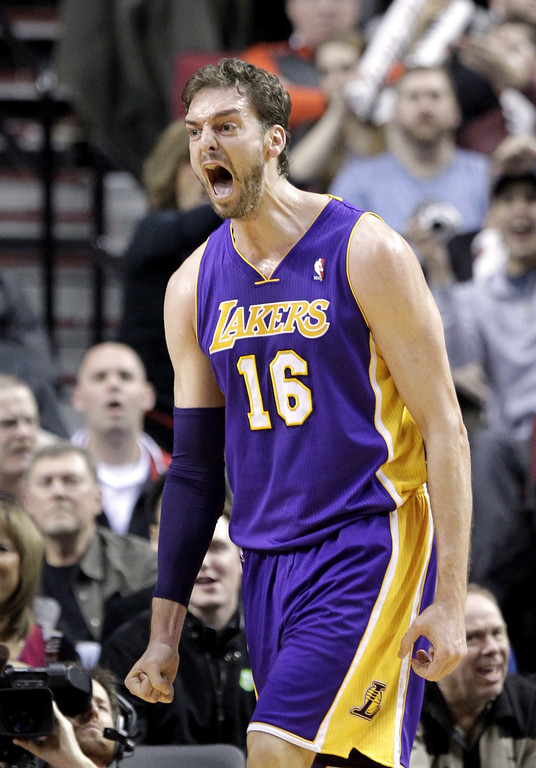 . Los Angeles Lakers center Pau Gasol, from Spain, reacts after scoring during the second half of an NBA basketball game against the Portland Trail Blazers in Portland, Ore., Monday, March 3, 2014.  Gasol topped the Lakers in scoring with 22 points as they won 107-106. (AP Photo/Don Ryan)