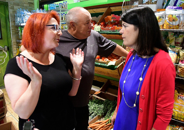 8/4/2018 Mike Orazzi | Staff Green Grocer owners Beata and Slawek Rulka talk with Connecticut 5th Congressional District democratic candidate Mary Glassman in New Britain Saturday.