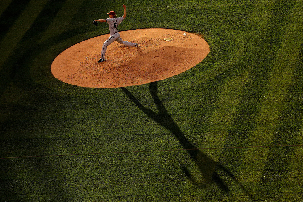 . Starting pitcher Bronson Arroyo #61 of the Arizona Diamondbacks delivers to home plate during the third inning against the Colorado Rockies at Coors Field on June 5, 2014 in Denver, Colorado.  (Photo by Justin Edmonds/Getty Images)