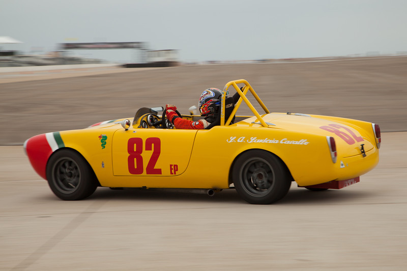 Brian Mertz prepares his 1965 Alfa Romeo Guilia Spider for turn eleven.