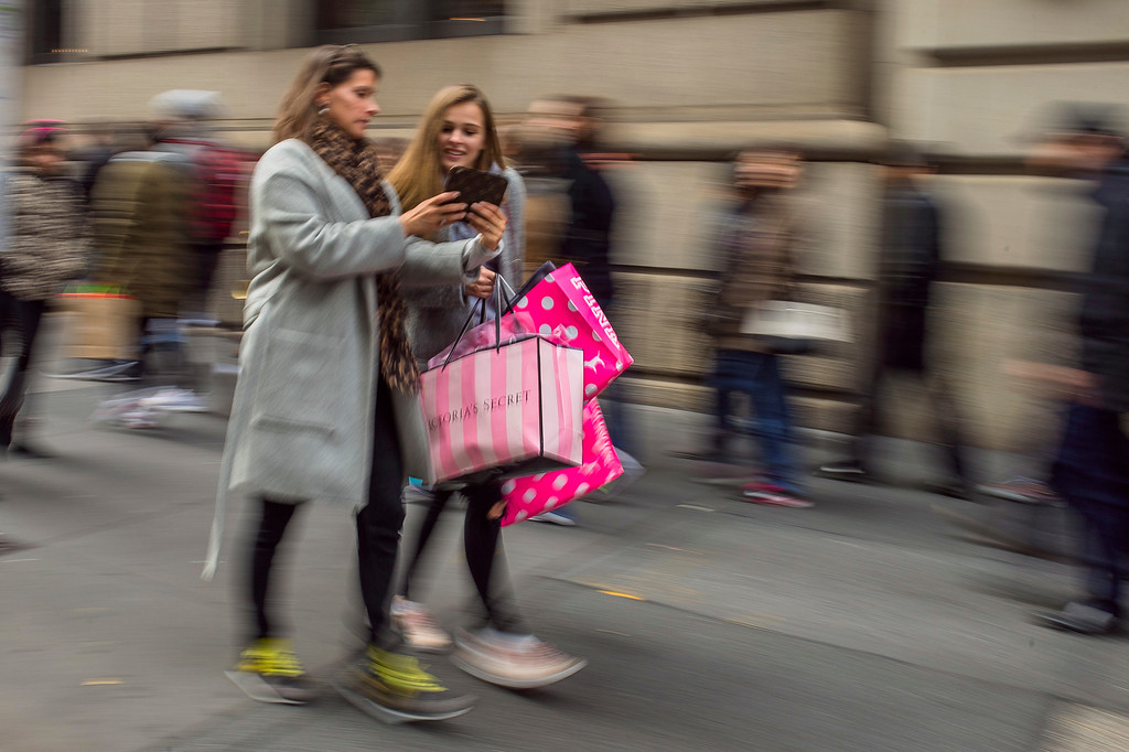 . Shoppers carry their purchases as they walk along Fifth Avenue on Black Friday in New York, Friday, Nov. 25, 2016. Stores opened their doors Friday for what is still one of the busiest days of the year, even as the start of the holiday season edges ever earlier.  (AP Photo/Andres Kudacki)