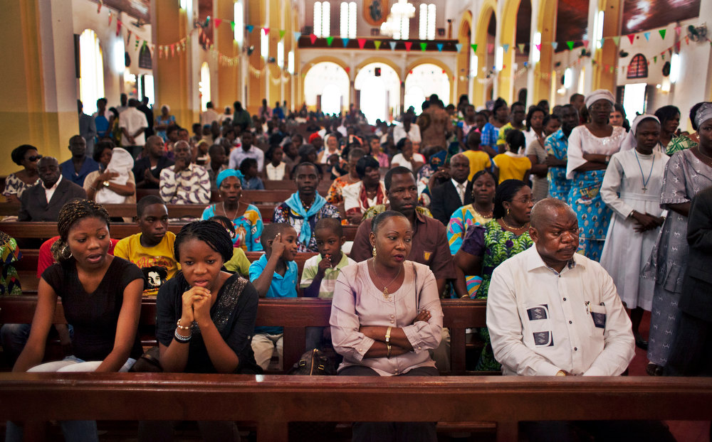 . Churchgoers attend a New Year\'s Day morning mass at the Notre Dame Cathedral of the Immaculate Conception in Bangui, Central African Republic, Tuesday, Jan. 1, 2013. President Francois Bozize\'s government is coming under growing threat as rebels vowing to overthrow him rejected appeals from the African Union to hold their advance and try to form a coalition government. (AP Photo/Ben Curtis)