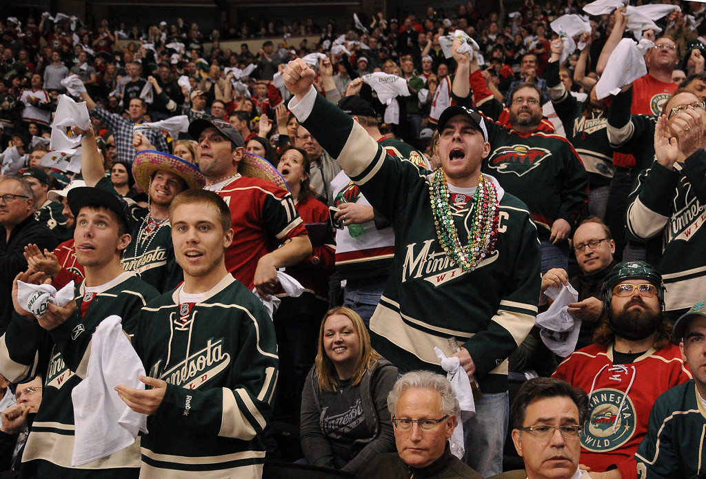 . Minnesota Wild fans cheer a penalty call on Chicago in the second period. (Pioneer Press: John Autey)