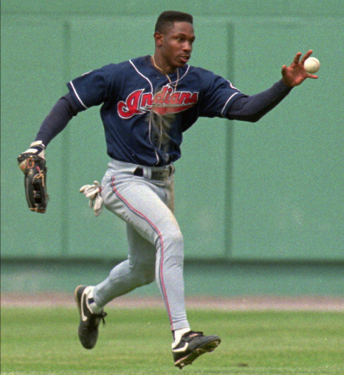 . KENNY LOFTON -- Cleveland Indians center fielder Kenny Lofton grabs the ball with his bare hand preventing Boston Red Sox\' Mike Macfarlane from  stretching a single into a double in the fourth inning at Fenway Park in Boston on May 21, 1995.      (AP Photo/Jim Rogash)