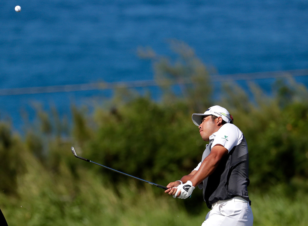 . Hideki Matsuyama, of Japan,  chips onto the 12th green during the final round of the Tournament of Champions golf event, Sunday, Jan. 8, 2017, at Kapalua Plantation Course in Kapalua, Hawaii. (AP Photo/Matt York)