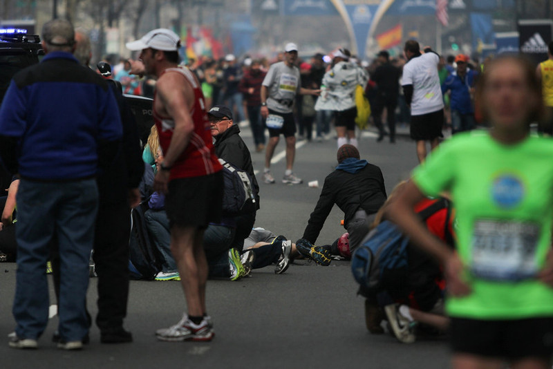 . Injured people are attended to at the scene of an explosion at the Boston Marathon, in Boston, Massachusetts, April 15, 2013. Two explosions struck the marathon as runners crossed the finish line on Monday, witnesses said, injuring an unknown number of people on what is ordinarily a festive day in the city. REUTERS/Daily Free Press/Kenshin Okubo/Boston University/Handout