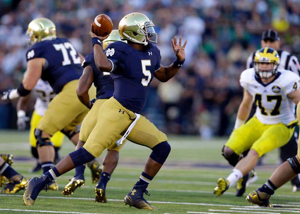 . Notre Dame quarterback Everett Golson throws against Michigan during the first half of an NCAA college football game in South Bend, Ind., Saturday, Sept. 6, 2014. (AP Photo/Michael Conroy)