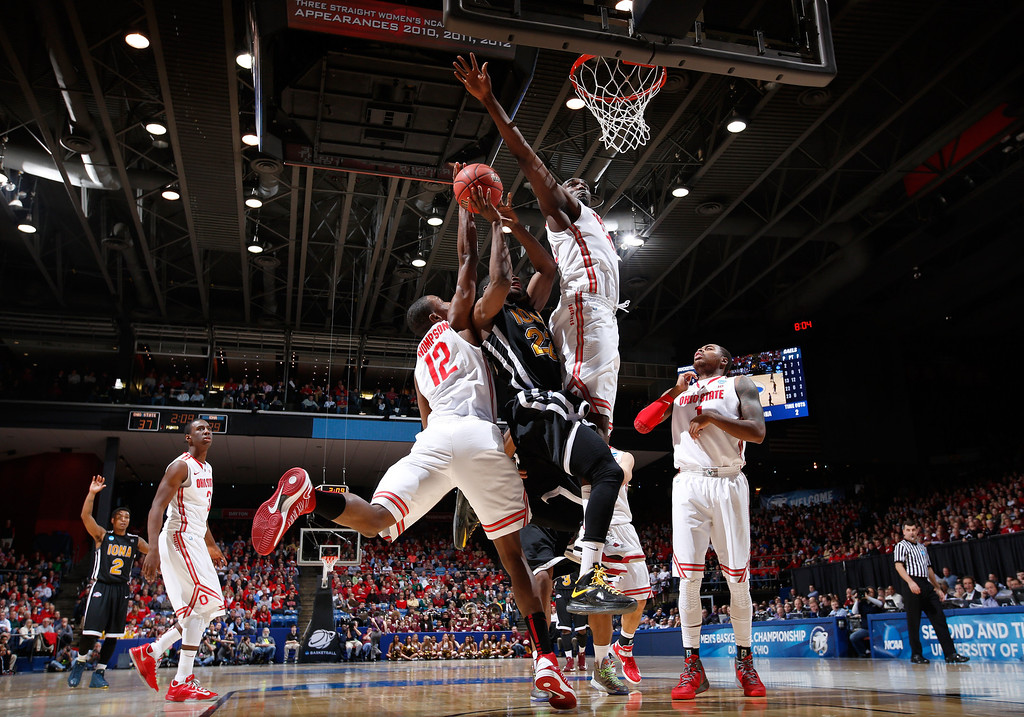 . DAYTON, OH - MARCH 22: Sean Armand #22 of the Iona Gaels drives to the basket against Sam Thompson #12 and Lenzelle Smith, Jr. #32 of the Ohio State Buckeyes in the first half during the second round of the 2013 NCAA Men\'s Basketball Tournament at UD Arena on March 22, 2013 in Dayton, Ohio.  (Photo by Joe Robbins/Getty Images)