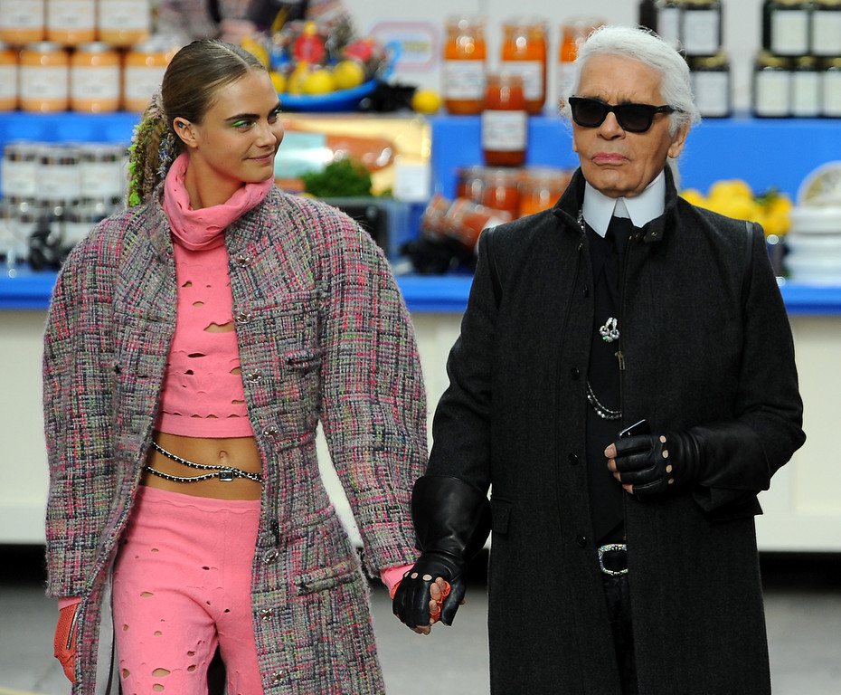 . Fashion Designer Karl Lagerfeld and model Cara Delevingne appear at the end of the runway during the Chanel show as part of the Paris Fashion Week Womenswear Fall/Winter 2014-2015 on March 4, 2014 in Paris, France.  (Photo by Francois Durand/Getty Images)