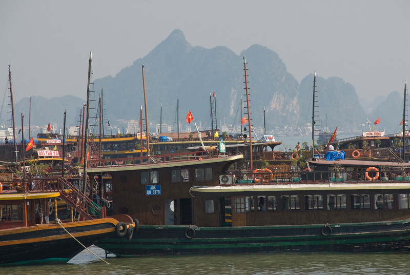 Empty sails on ships in harbor - Ha Long Bay, Vietnam