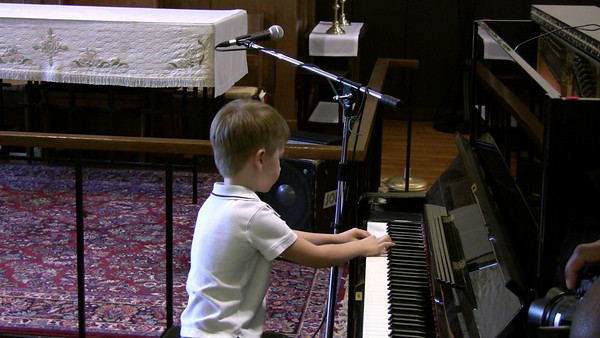 "June 2009.  Peter performs at annual MMM recital in Medfield ""Toccata in D minor"" by Bach ""Bionicle battle"" by Peter ""For Elise"" by Beethoven"