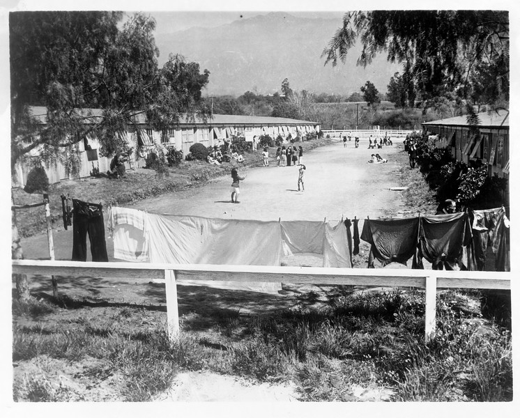 """""""General view of Japanese internment camp at Santa Anita Race Track.  With removal of the Nipponese the Army will utilize the camp, thus preventing hoped for renewal of racing.""""--caption on photograph"""
