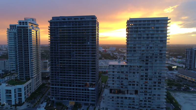 Aerial drone reveal video sunset behind buildings motion 4k