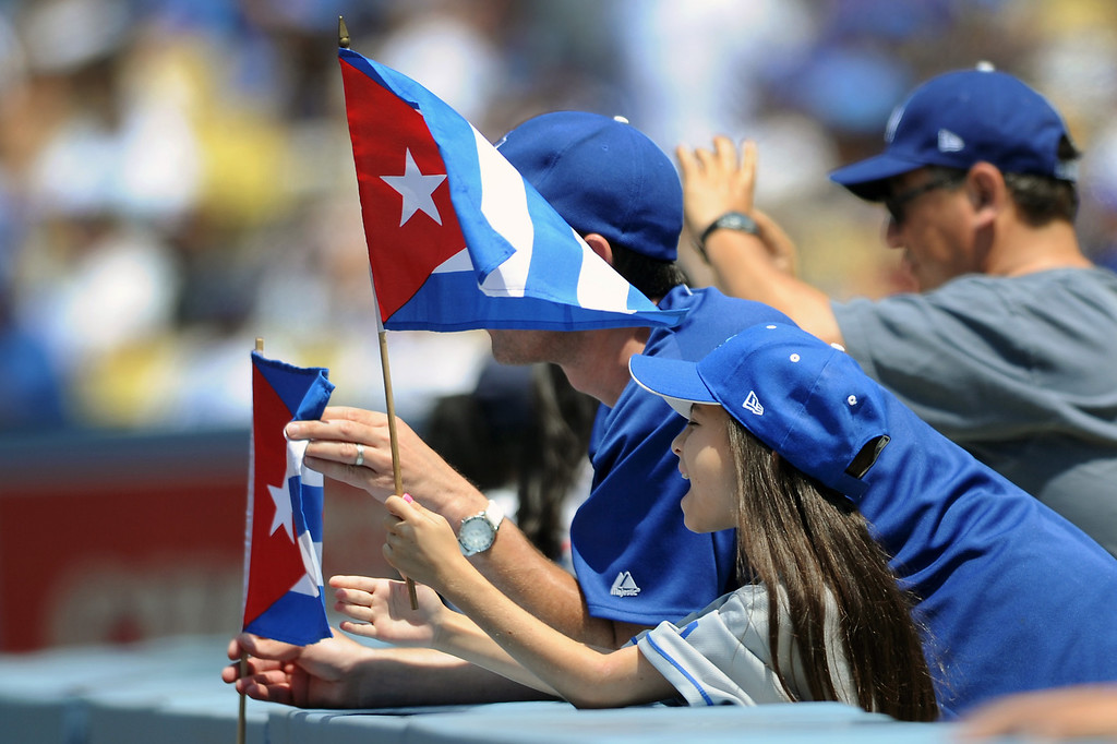 . A couple fans hold Cuban flags for Yasiel Puig. Saturday, August 10, 2013, at Dodger Stadium. (Michael Owen Baker/L.A. Daily News)