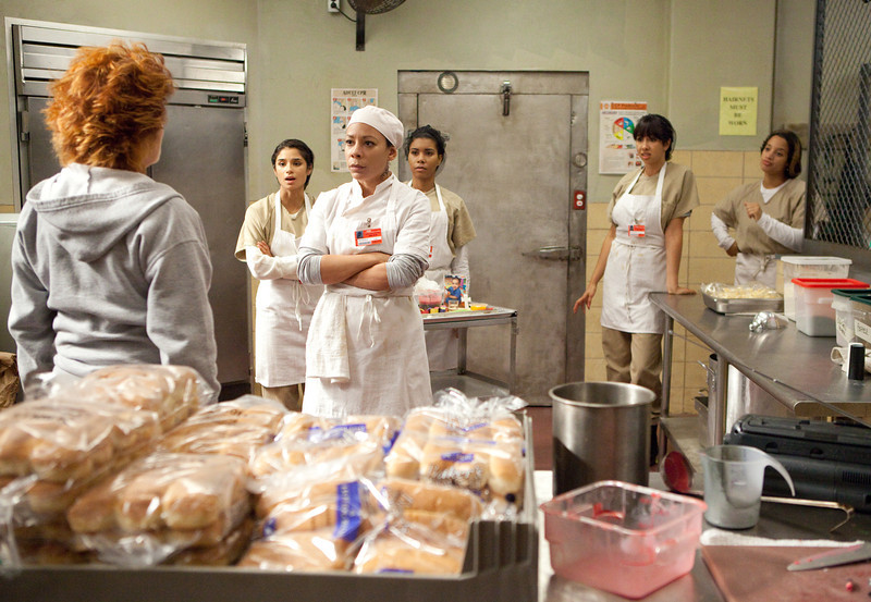 . (L-R) Kate Mulgrew, Diane Guerrero, Selenis Leyva, Jessica Pimentel, Jackie Cruz and Dascha Polanco in a scene from Netflix�s �Orange is the New Black� Season 2. (K.C. Bailey, Netflix)