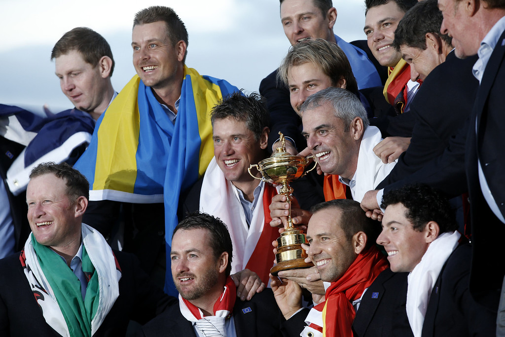 . Team Europe poses for pictures with the trophy after they retained the Ryder Cup on the final day of the Ryder Cup golf tournament at the Gleneagles Hotel in Gleneagles, Scotland, on September 28, 2014. Jamie Donaldson grabbed the crucial point Paul McGinley\'s side needed for the win when he defeated Keegan Bradley 4 and 3 in the 10th of the closing 12 singles. AFP PHOTO/ADRIAN DENNIS