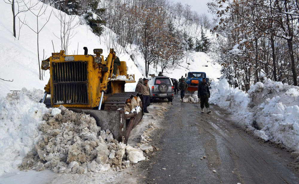 Description of . A snow plow machine works to clear the highway in Banihal, India, Saturday, Jan. 19, 2013. Traffic on the 300 kilometers (186 miles) long Jammu-Srinagar national highway was suspended due to heavy snowfall, according to news reports. (AP Photo)