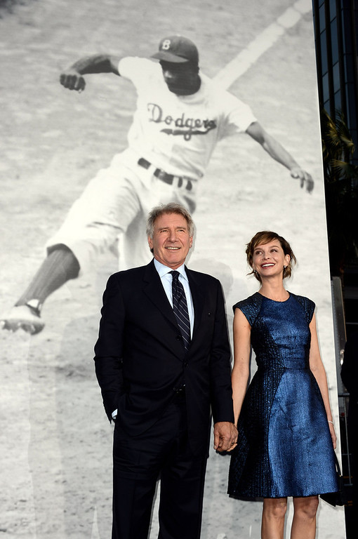 """. Actor Harrison Ford (L) and his wife actress Calista Flockhart arrive at the premiere of Warner Bros. Pictures\' and Legendary Pictures\' \""""42\"""" at the Chinese Theatre on April 9, 2013 in Los Angeles, California.  (Photo by Kevin Winter/Getty Images)"""