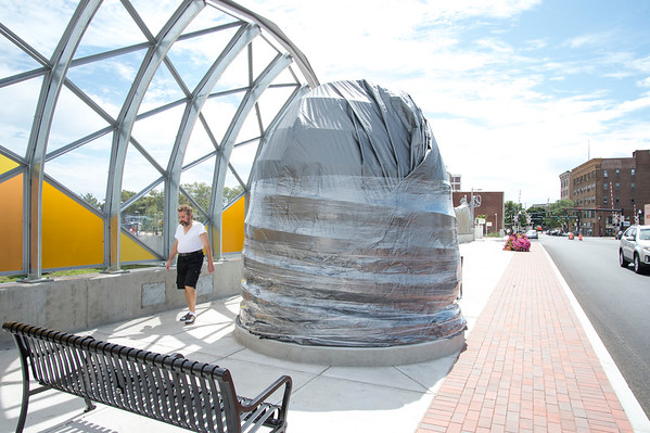 08/27/19 Wesley Bunnell | Staff A bee hive sculpture is still under wraps on the Bee Hive Bridge on Tuesday August 27, 2019.
