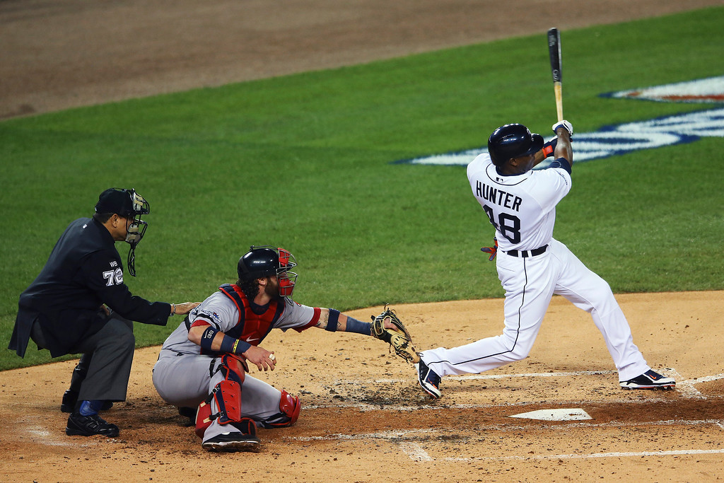 . Torii Hunter #48 of the Detroit Tigers hits a two RBI double in the second inning against the Boston Red Sox during Game Four of the American League Championship Series at Comerica Park on October 16, 2013 in Detroit, Michigan.  (Photo by Mike Ehrmann/Getty Images)