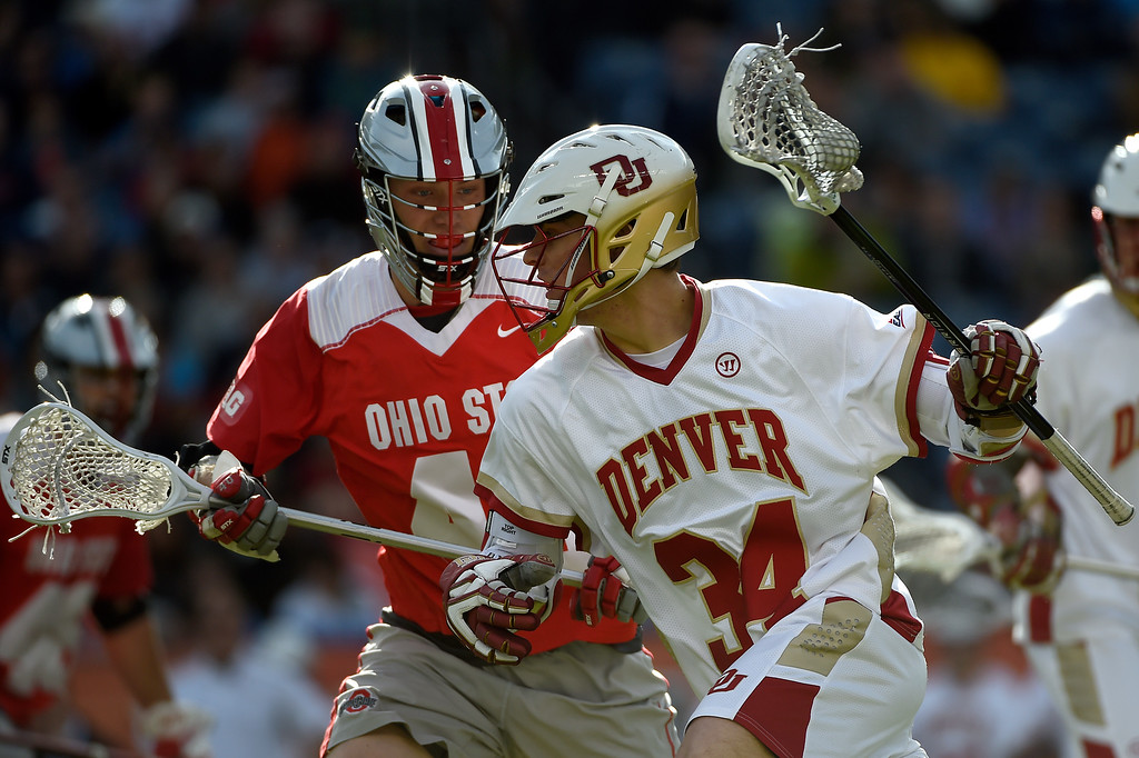 . Ryan Borcherding (40) of the Ohio State Buckeyes defends  Erik Adamson (34) of the Denver Pioneers during the first half of their NCAA tournament quarterfinal match. The Denver Pioneers played the Ohio State Buckeyes at Sports Authority field at Mile High on Saturday, May 16, 2015. (Photo by AAron Ontiveroz/The Denver Post)