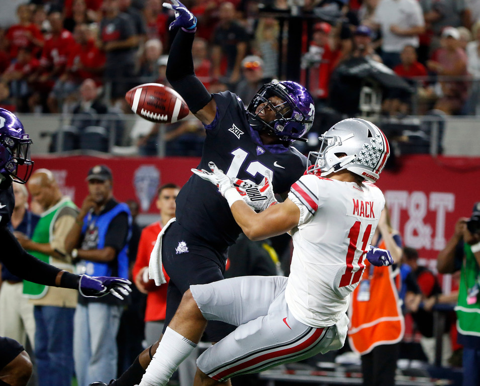 . TCU cornerback Jeff Gladney (12) defends a pass intended for Ohio State wide receiver Austin Mack during the first half of an NCAA college football game in Arlington, Texas, Saturday, Sept. 15, 2018. (AP Photo/Michael Ainsworth)