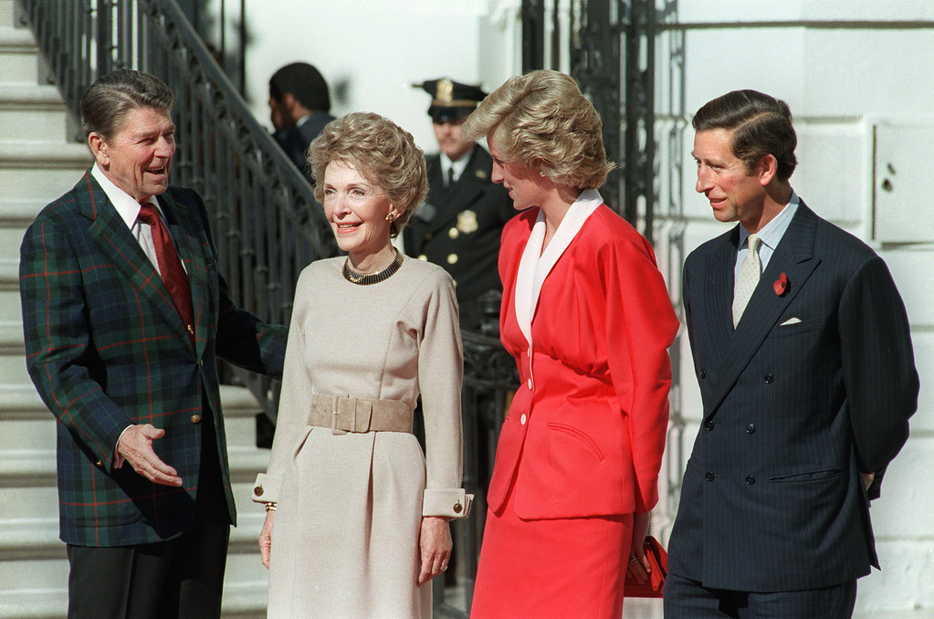 . US President Ronald Reagan and his wife Nancy welcome Princess Diana and her husband Prince Charles. The Royal Couple arrived in Washington, D.C. for a three-day visit before traveling on to Florida November 9, 1985.   (DON RYPKA/AFP/Getty Images)