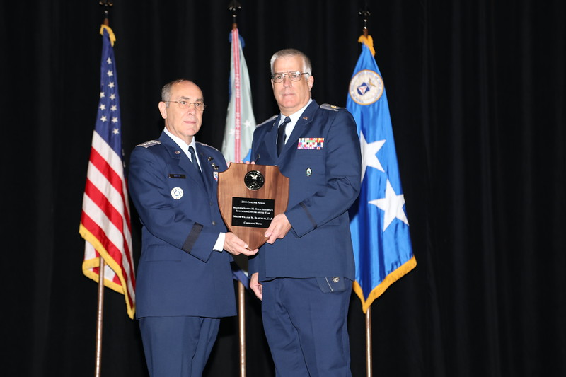 The Maj Gen Jeanne M. Holm Aerospace Education Officer of the Year Award is presented to Maj William Blatchley.  Among other things, Maj Blatchley served as coach of CAP's 2017 National Championship team, winning the CyberPatriot competition's All Service Division.  His Colorado Springs Cadet Squadron team has won the national title twice in the past 5 years, and he has taken the team to the national finals a record 8 years.  Photo by Susan Schneider, CAPNHQ