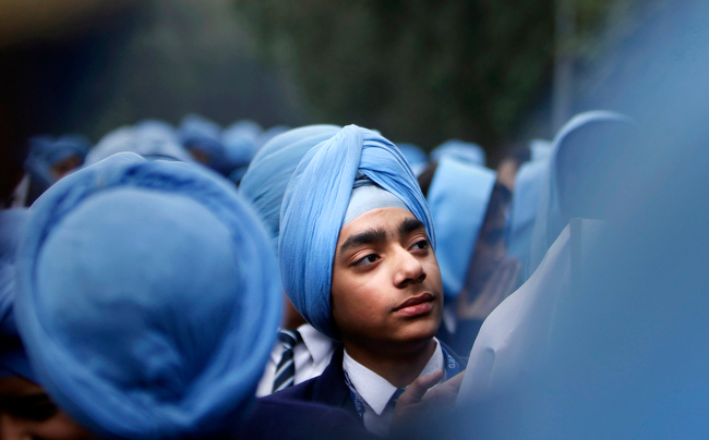 . Indian Sikh school students participate in a protest against the ban on wearing turban in public schools in France, in New Delhi, India, Friday, Feb. 15, 2013  on the occasion of a two-day visit of French President Francois Hollande in India. (AP Photo/Tsering Topgyal)