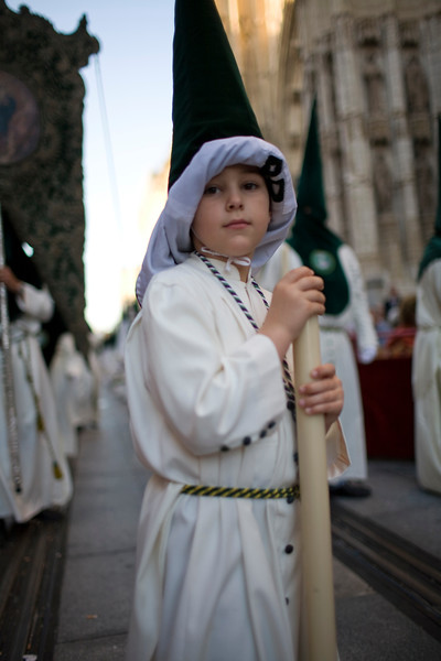Young penitent with raised hood