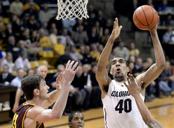 . Colorado\'s Josh Scott takes a shot in front of Jordan Bachynski during a game against Arizona State on Wednesday, Feb. 19, in Broomfield, Colorado. Jeremy Papasso/Boulder Daily Camera