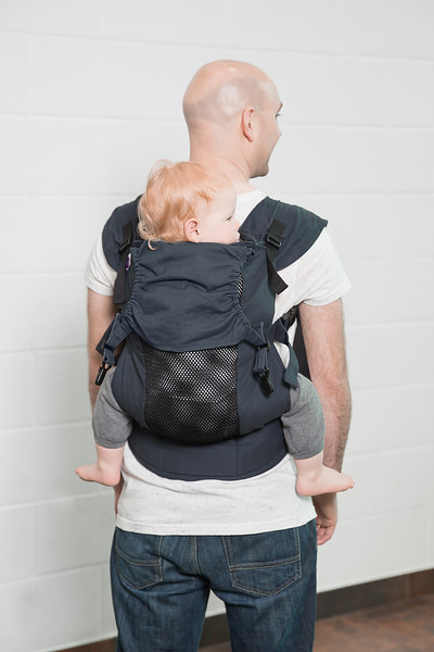 Izmi_Accessories_Lifestyle_Hood_Midnight_Blue_On_Midnight_Blue_Toddler_Carrier_Dad_Back_Carry.jpg