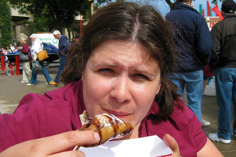 Darcie sampling a deep-fried Snickers bar