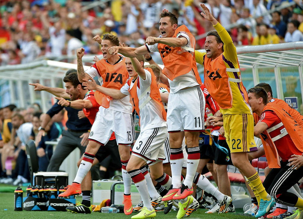 . German players celebrate during the Group G football match between Germany and Portugal at the Fonte Nova Arena in Salvador during the 2014 FIFA World Cup on June 16, 2014.   PATRIK STOLLARZ/AFP/Getty Images