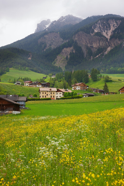 Val di Funes Valley is a wonderland of natural beauty and lovely alpine chalets.  The yellow flowers and grassy fields fill the valley while the dolomite mountains circle around.