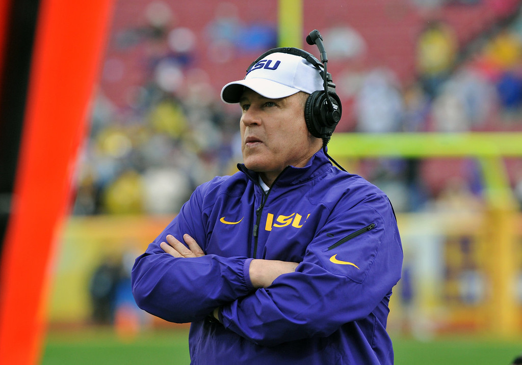 . Coach Les Miles of the LSU Tigers directs play against the Iowa Hawkeyes January 1, 2014  in the Outback Bowl at Raymond James Stadium in Tampa, Florida.  (Photo by Al Messerschmidt/Getty Images)