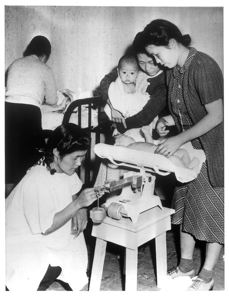 """""""Daily the Baby Clinic at Santa Anita Assembly center is crowded like this.""""--caption on photograph"""