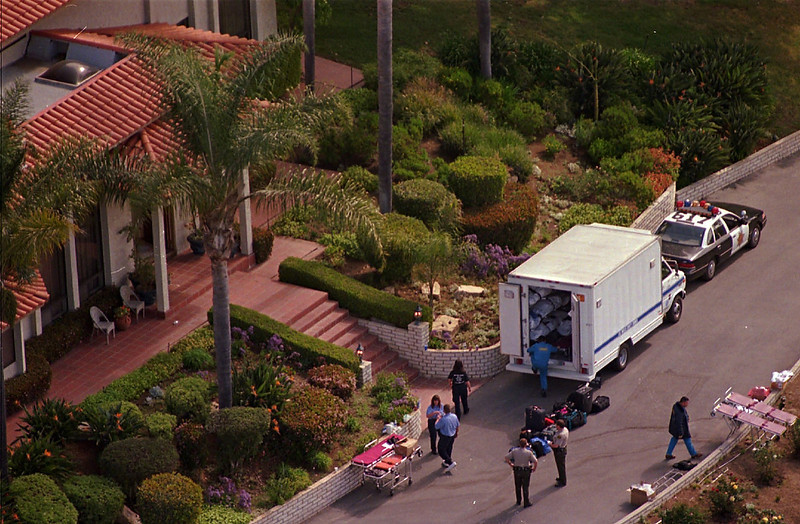". A Los Angeles County Coroner\'s truck stands by Thursday March 27, 1997 to transport some of the 21 women and 18 men found dead Wednesday at a mansion in Rancho Santa Fe, Calif., after an apparent mass suicide. After it was reported there was an object trailing the comet Halle-Bopp, Heaven\'s Gate cult members took it as a sign aliens had come for them and that they had to abandon their ""vehicles\"" or bodies to be reunited with the aliens and saved from armageddon. (AP Photo/Mark J. Terrill)"