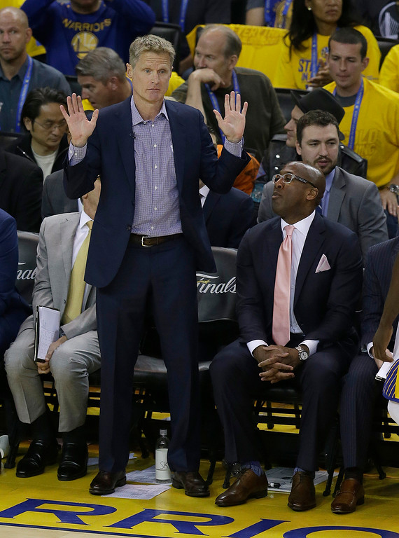 . Golden State Warriors head coach Steve Kerr, left, gestures next to Mike Brown during the first half of Game 2 of basketball\'s NBA Finals against the Cleveland Cavaliers in Oakland, Calif., Sunday, June 4, 2017. (AP Photo/Ben Margot)