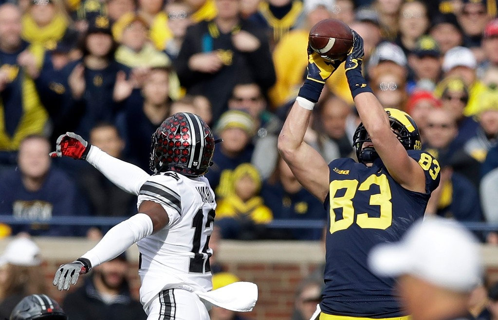 . Michigan tight end Zach Gentry (83) catches a pass defended by Ohio State cornerback Denzel Ward (12) during the first half of an NCAA college football game, Saturday, Nov. 25, 2017, in Ann Arbor, Mich. (AP Photo/Carlos Osorio)