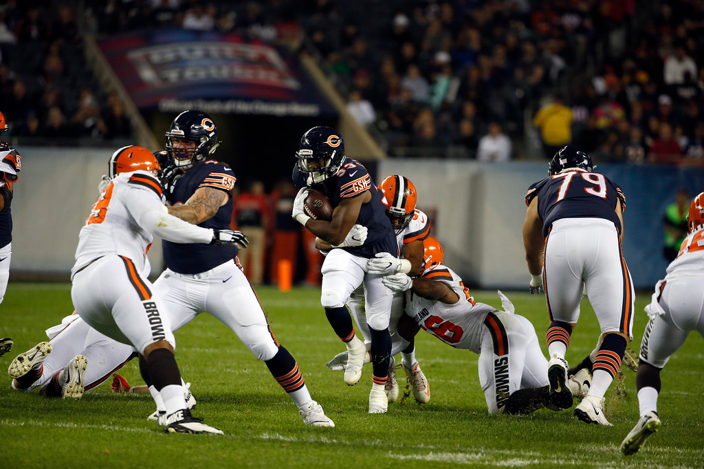 . Chicago Bears running back Jeremy Langford (33) runs against Cleveland Browns defensive end Tyrone Holmes (91) and linebacker Deon King (56) during the first half of an NFL preseason football game, Thursday, Aug. 31, 2017, in Chicago. (AP Photo/Nam Y. Huh)