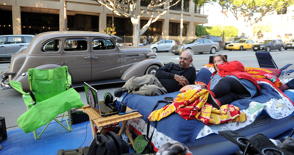 . Peter and Patricia Canon of San Pedro camp out with an air mattress, television and heat for the Rose Parade along Colorado Boulevard in Pasadena, Calif., on Tuesday, Dec. 29, 2013.     (Keith Birmingham Pasadena Star-News)