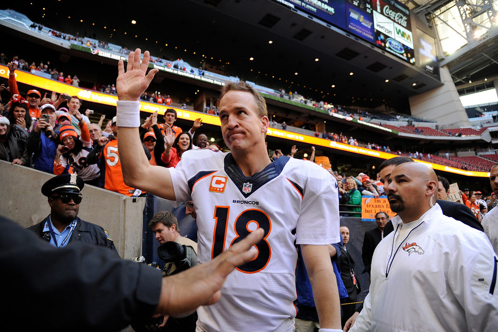 . Quarterback Peyton Manning #18 of the Denver Broncos waving to the fans after winning against the Houston Texans at Reliant Stadium December 22, 2013 Houston, Texas. (Photo By Joe Amon/The Denver Post)