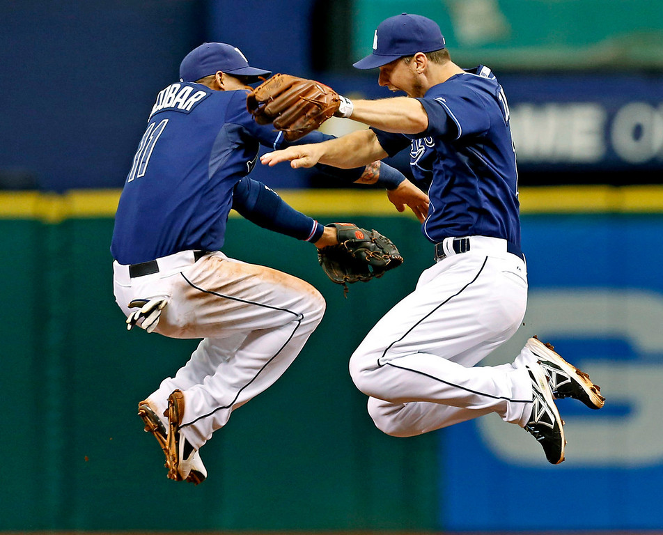 . Tampa Bay\'s Yunel Escobar, left, and Ben Zobrist celebrate after knocking off the Minnesota Twins, 4-3, for a series sweep at Tropicana Field in St. Petersburg, Fla., on Thursday, July 11, 2013. (AP Photo/Mike Carlson)