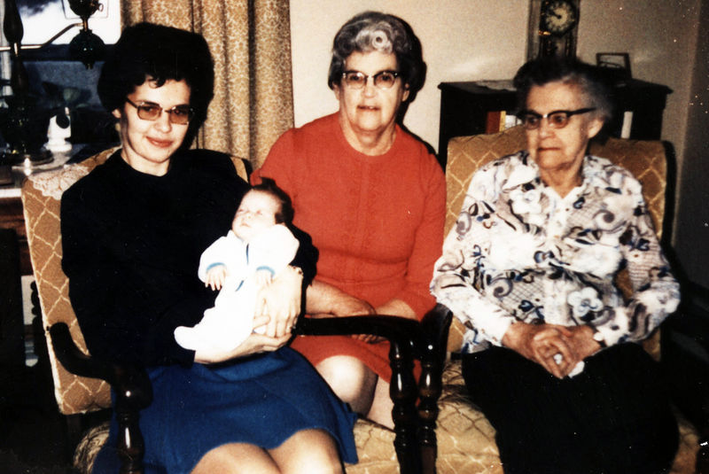 Ellen being held by her mother, to the right is her grandmother and great grandmother