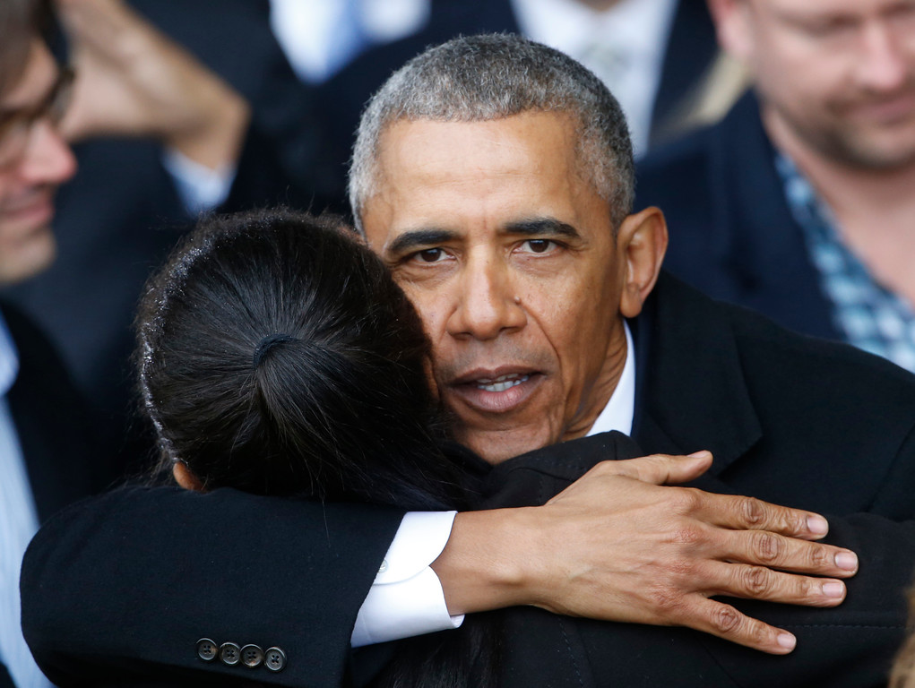 . Former President Barack Obama hugs supporters as he prepares to depart Andrews Air Force base in Andrews Air Force Base, Md., Friday, Jan. 20, 2017. (AP Photo/Steve Helber)